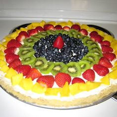 A baked cookie crust is spread with cream cheese and whipped topping, and fresh fruit is spiraled onto the top. A sweetened, citrus glaze is then spooned over the fruit. Chill this sweet pizza before serving. Sugar Cookie Pizza, Sugar Cookie Dough, Great Desserts, Dessert Recipes, Fun Recipes, Recipe Ideas, Sweet Pizza, Healthy Treats, Healthy Eating