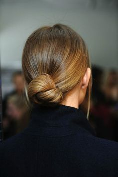 You can't go wrong with a sleek low bun.