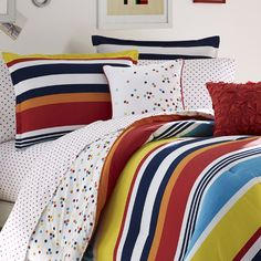 Featuring a polka-dot print and stripe details, this chic comforter set offers charming style for your guest room or teen's restful retreat....