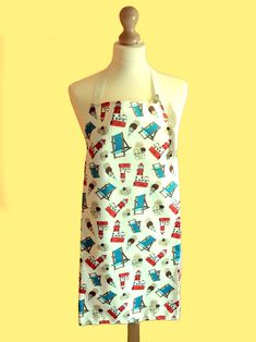 Seaside apron handmade with water resistant fabric. Seaside fabric inspired by the Northumberland coast.The perfect beach lover gift. Cleaning Wipes, Mother Day Gifts, Seaside, Hand Drawn, Printing On Fabric, How To Draw Hands, Summer Dresses, Aprons, Kitchenware