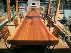 An outdoor table made of a slab from a naturally fallen redwood tree