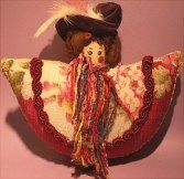 Pincushion doll made from vintage fabric, gimp, unusual yarn, velveteen hat with feather and wool hair.  For sale at http://barbspencerdolls.com