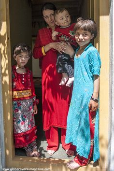 A lovely family in Gulmit Village in the Upper Hunza Valley north of the Attabad Lake, Hunza Vallay, PAKISTAN