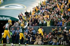 Green Bay Packers receiver Randall Cobb (18) celebrates after a touchdown during a game against the Washington Redskins at Lambeau Field in Green Bay, Wis., on September 15, 2013. Lukas Keapproth/Press Gazette Media