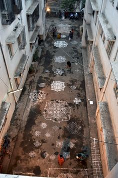"""""""Kolam is a rangoli traditionally composed of geometric lines and shapes, drawn around a grid pattern of dots. It is drawn by south Indian women with rice or chalk powder in front of their homes."""""""