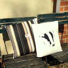 Gorgeous Badger Cushions, a badger design on one side complimented by black, taupe and white stripes on the other.  Made in the UK http://www.madecloser.co.uk/home-garden/homeware-and-furniture/badger-cushion-onyx-stripe