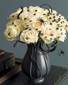 Black and white spider bouquet. Seems easy enough. You'd probably have to use fake roses though.