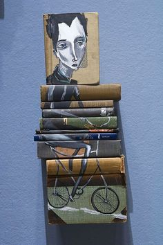 I'm absolutely loving these book paintings/sculptures by Mike Stilkey. Click to see more of his work.