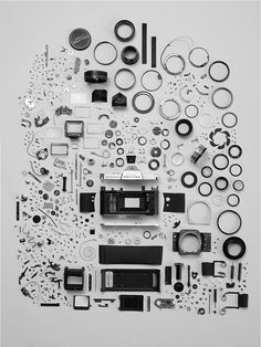 Camera parts wall display.  Must be in the office of a camera repairman!