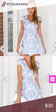 Xenia gold foil dress blue New with tags. Never been worn. Australian size 10, US size medium or small. Beautiful dress. More sorted top with flare bottom Xenia Dresses
