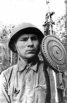 Untitled  15.(original caption). Red Army soldier with his Degytarev light machine gun. Date and location unknown.