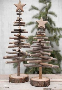 Alternative wood Christmas tree with a lovely star on top. It's a great rustic decor for a modern farmhouse! You can find other great Christmas decor pins on ItalianArtDeco! decorations christmas DIY de Noël - PLANETE DECO a homes world Twig Christmas Tree, Noel Christmas, Vintage Christmas, Christmas Ornaments, Christmas Design, Classy Christmas, Natural Christmas, Xmas Trees, Christmas Quotes