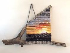 Bruneau Dunes in Idaho! This handmade branch weaving incorporates an original photograph of one of my favorite local Boise places to visit. The sunsets there are spectacular! Strips of the photo are woven into the piece, along with various yarns. Bruneau Dunes: Bruneau Dunes State