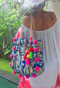 Nyang Pom Pom Beach & Yoga Bag  Colorful fabric in 100% rayon. Add a casual chic look for your beach day!!! Features: - Top width: 43 cm approx. - Bottom width: 39 cm approx. - Height: 42 cm approx. - Bottom dept: 15 cm - Synthetic Handles Height: 26 cm approx.  Zip closure with 1 open 15 cm width internal pocket.  Color:  - Red & Gray & Black & Pink - Pompom Red  - Red & Gray & Pink - Pompom Neon Salmon  - Blue & Beige - Hot Pink Pompom  ** Items made to order ple...