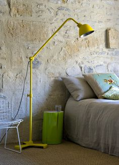 An Amusing Shocking Yellow Satnding Lamp For Reading In A Stony Bedroom With Neon Green Trunk Table Style Beautiful Country House in Italy with Warm Interior Home design Yellow Floor Lamps, Cool Floor Lamps, Log Side Table, Brick Interior, Geometric Decor, Home And Deco, Wabi Sabi, Contemporary Interior, Interior Design Inspiration