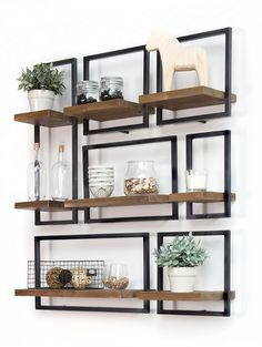 SHELFMATE in short: A piece of premium teak wood that 'floats' in a stylish, black iron frame. The combination of wood and iron is the signature of d-Bodhi. http://amzn.to/2sBUZBN
