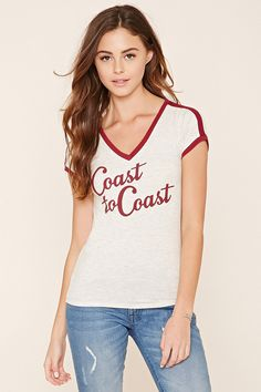 "A stretch-knit tee featuring a V-neckline, contrast trim, short sleeves, and a ""Coast To Coast"" graphic on the front."