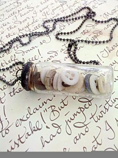 Wish we could find these small bottles...great necklace.  you could change the colors of the buttons to match your clothes.....Antique Baby Button Soldered Glass Vial Necklace