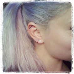 Pastel hair and bar earring killing the game. #refinery29 http://www.refinery29.com/extreme-piercing#slide-15