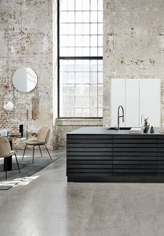 We love this stylish kitchen island in black oak. Designed by Kvik Kitchens.