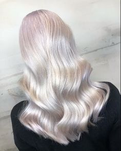 Cool silver tones with a milky metallic shine creates a magical pearl blonde. Crafted by Wella Educator Laila Pettersen.