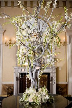manzanita tree, entry, decor, reception: Right outside the reception hall entry, place a tall Manzanita tree decorated with hanging candles and flowers or a grouping of mix-and-match vases filled with rich flowers of various textures to match the rest of the reception.
