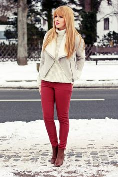 Pale grey or white jacket, white sweater, red jeans with brown booties.