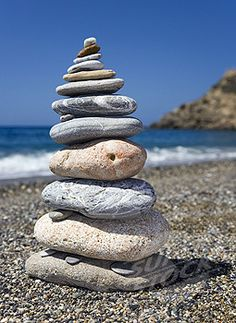 SuperStock - Gravel beach stones tower stacked beach shingle stone-turrets stack