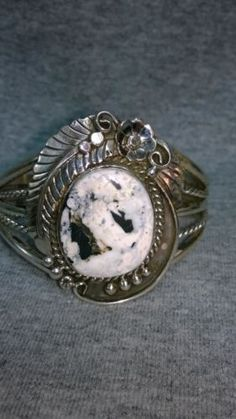 Navajo-white-buffalo-turquoise-sterling-silver-bracelet-signed-by-Betta-Lee