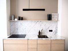 Selina Lauck - home tour - marble and wood kitchen