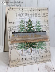 Trees on Christmas music, with parchment sentiment on top