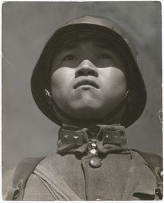 The Boy Soldier, Hankou, China, late March 1938. Photo by Robert Capa.    Unusual and striking angle.    May 16, 1938 Cover of Life Magazine.