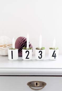 Pin for Later: 14 Ways to Shake Up Your Holiday Decor Celebrate Advent with this unique idea: candles with numbered holders filled with greenery. Nordic Christmas, Pink Christmas, Christmas And New Year, Winter Christmas, Christmas Time, Merry Christmas, Xmas, Christmas Ideas, Birthday Decorations