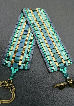 Colorful Tila Bracelet. Miyuki Tila Beads. Blues, Green and Gold. Beautiful Dragonfly Clasp. This Bracelet Looks Great Dressing Up Or Wearing Your Favorite Pair Of Jeans. Sure To Get Attention  Ready to Ship!!  Thanks For Stopping By My Shop