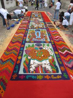 Visit Antigua, Guatemala during Semana Santa when the alfombras (carpets) are created in the streets from sand and flowers. I lived there a month 10 years ago for Spanish immersion. An amazing city.