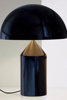 Atollo Table Lamp By Vico Magistretti for Oluce embraces the dark and dramatic in rich, full finishes and impeccable design and balance.