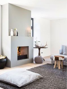 Fantastic living room with fireplace and large carpet. Very cozy interior . Fantastic living room with fireplace and large carpet. Home Fireplace, Living Room With Fireplace, Fireplace Design, Home Living Room, Living Spaces, Fireplace Ideas, Simple Fireplace, Concrete Fireplace, Apartment Living
