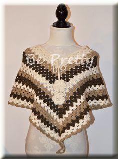 Poncho de crochet em linha de algodão com florinhas. Crochet poncho in cotton thread with little flowers.