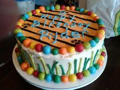 Boys birthday cake large bottom layer to match the tiger cake topper.