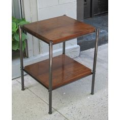 Metal Edged table with plank American walnut shelves