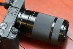 closeup of sony-55-210mm lens on camera