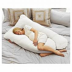Pregnancy pillow..NEED! too bad my bed is full almost every night from a crazy sleeping man and a toddlerrr:/