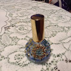 4 inch high jeweled perfume bottle with stopper. Can be used as a perfume bottle or as a decoration.