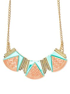 Graphic, bold and deliriously beautiful, this is one statement maker of a necklace. Not only does it work a playful vibe in bright blue and coral, but the zigzag motif makes it extra mesmerizing.