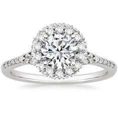 engagement ring=love the halo setting with the row of diamonds pave'  set around the outer edge of halo. Found on Brilliant Earth web.