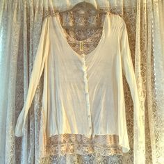 Free people lace back off-white long sleeve shirt Completely lace backed very soft off white Free People shirt. Very good condition!  Shirt is button down in the front. See picture for tiny hole Free People Tops Blouses