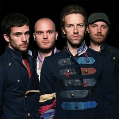 Don't really find Chris Martin sexy but bass player Guy Berryman (far left) sure is! I love Coldplay!