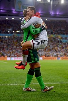 Manuel Neuer & Miroslav Klose celebrating after Germany finally scored a goal in that long, painfully suspenseful game against Algeria - World Cup 2014