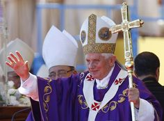 """Pope Benedict XVI waves to the crowd after celebrating mass at Revolution Square in Havana March 28, 2012. Pope Benedict, speaking from Cuba's biggest stage, urged Cubans on Wednesday to search for """"authentic freedom"""" as their country changes and pressed the island's communist government to give the Catholic Church more liberties, including the right to teach religion in schools and run universities"""
