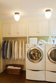 Laundry done right.  Lifted washer and dryers, hanging rack, cupboards/storage.  Just needs a bench